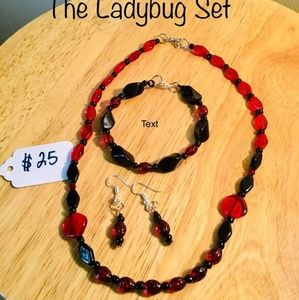 Hand beaded necklace bracelet and earrings